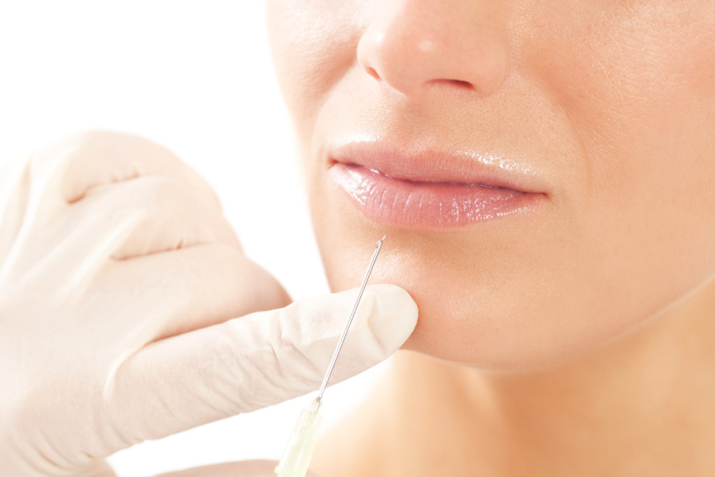 Botox - Age and beauty; a doctor is doing the injection