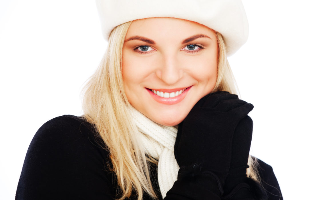 pretty woman in beret and scarf. isolated on white background