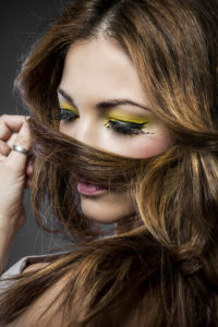 Spanish beautiful woman with long blond hair, painted yellow eyes with big eyelashes