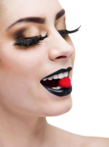 beauty woman with long lashes and black lips over white background