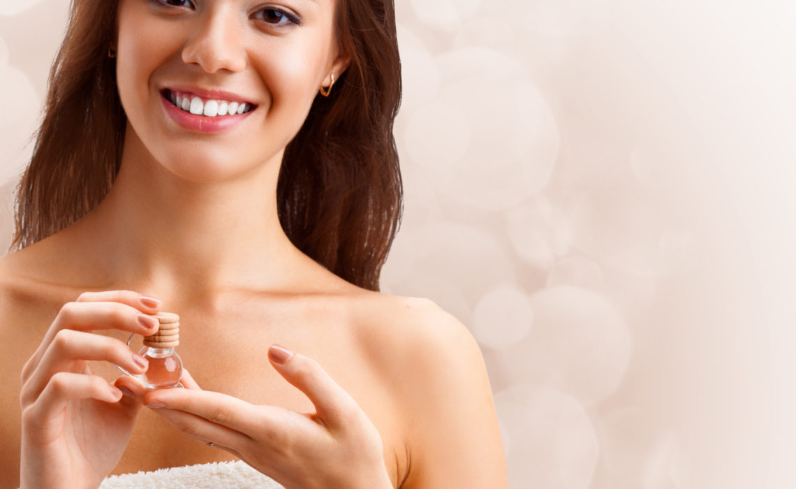 beautiful woman holding oil jar