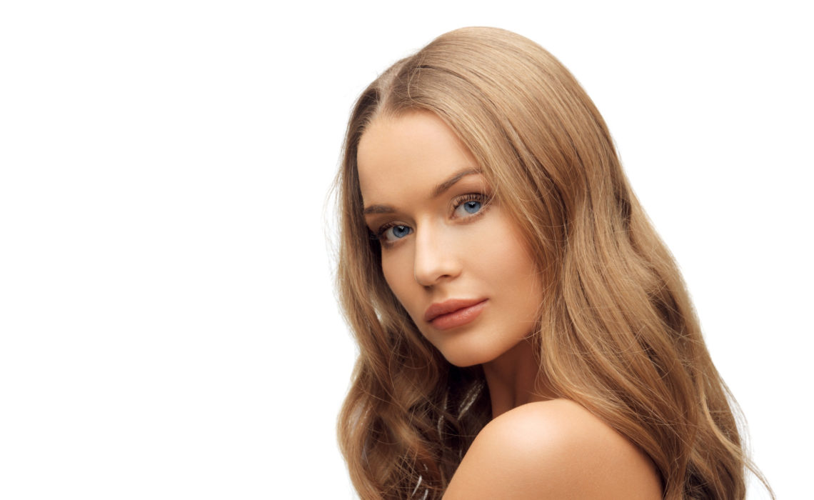 people, beauty and hair care concept - beautiful woman face with long blond hair