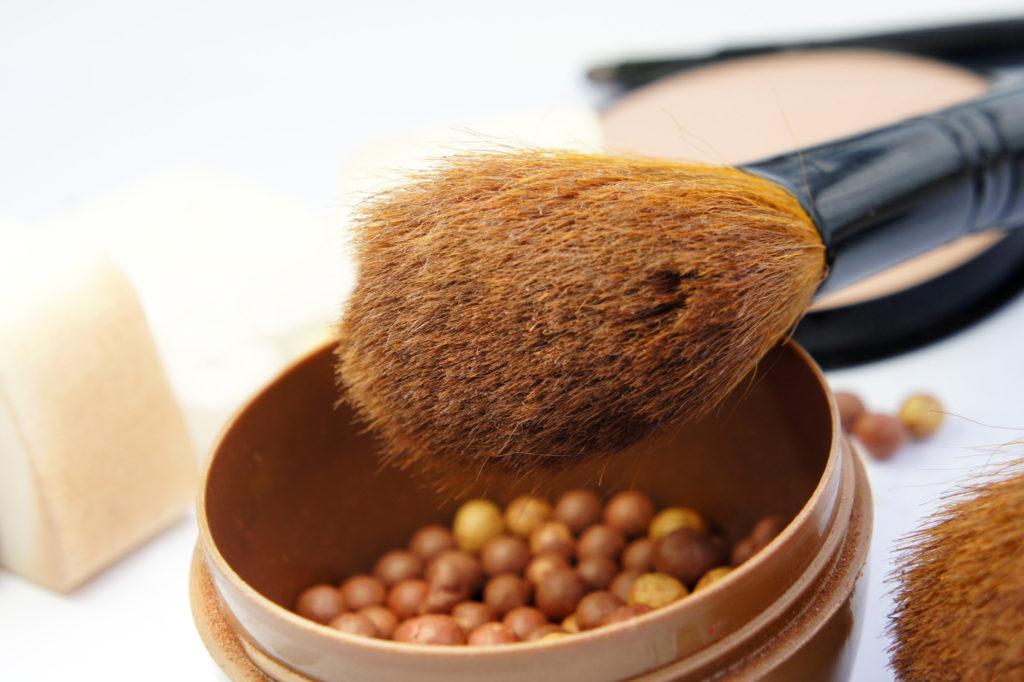 Makeup room: makeup foundation, powder, bronzer and brushes
