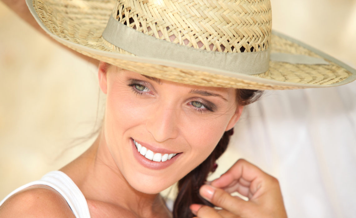 Pretty woman wearing straw hat