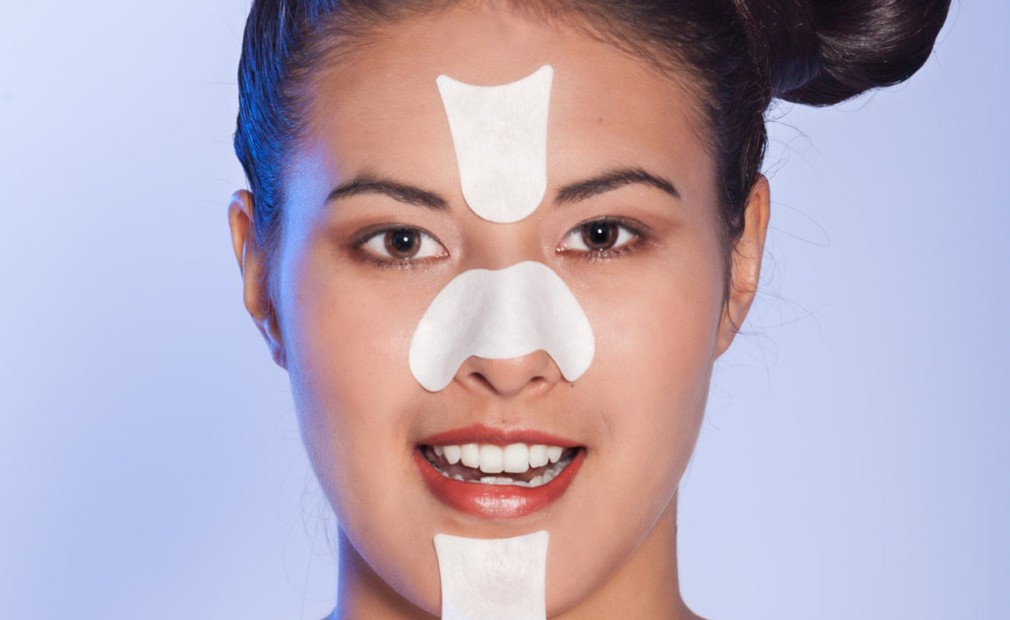 Young woman with facestrips and nosestrips in her face