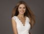 fashion studio photo of beautiful smiling woman with long hair wears luxurious sequin dress