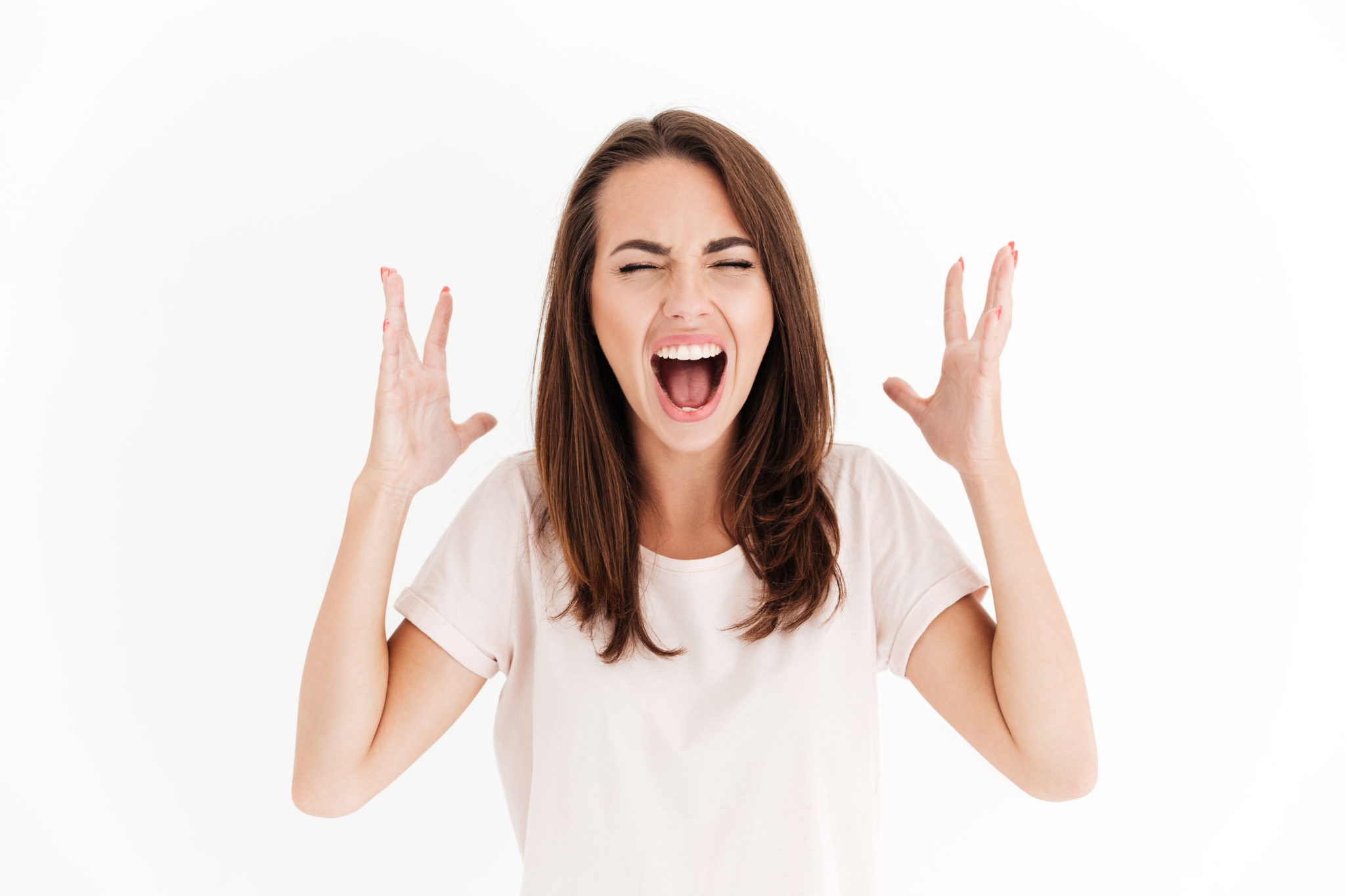 Screaming brunette woman in stress over white background