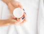 Female person hands with cosmetic cream closeup, skincare. Bodycare and hygiene, healthcare