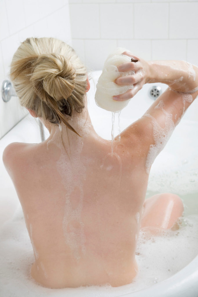 Woman washing in bubble bath
