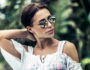 Portrait of a gorgeous woman in rainforest, attractive sexy model wearing stylish sunglasses, enjoying summer vacation in tropical islands