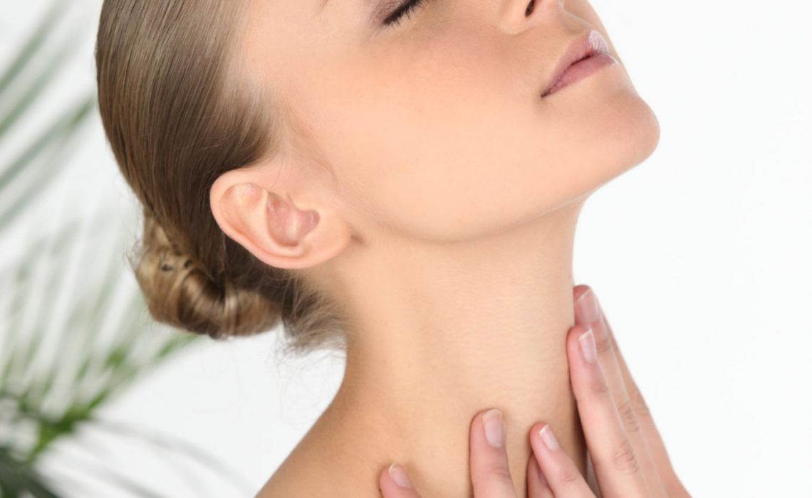 Woman rubbing her own neck