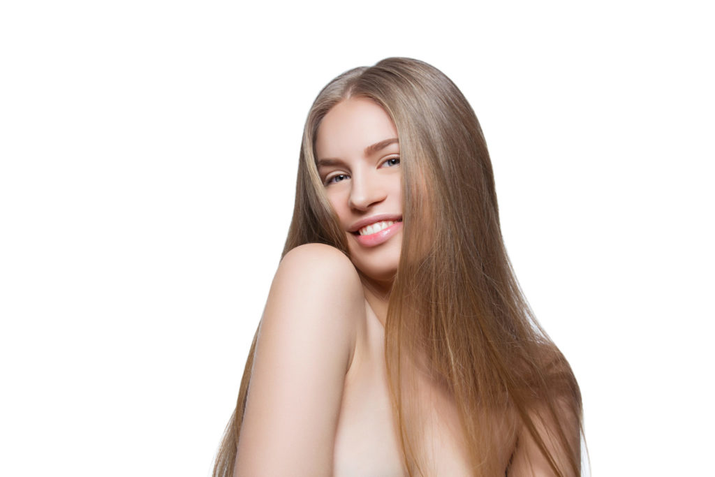 Beautiful young woman with natural makeup and long blond healthy hair. Isolated over white background. Copy space.
