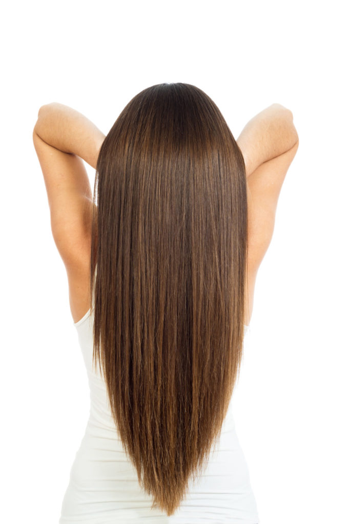 beautiful female long hair were photographed in studio on a white background
