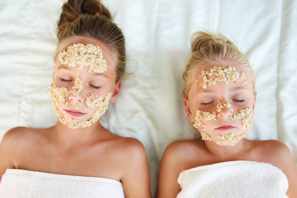 Beautiful girls with facial mask of oatmeal. Top view.
