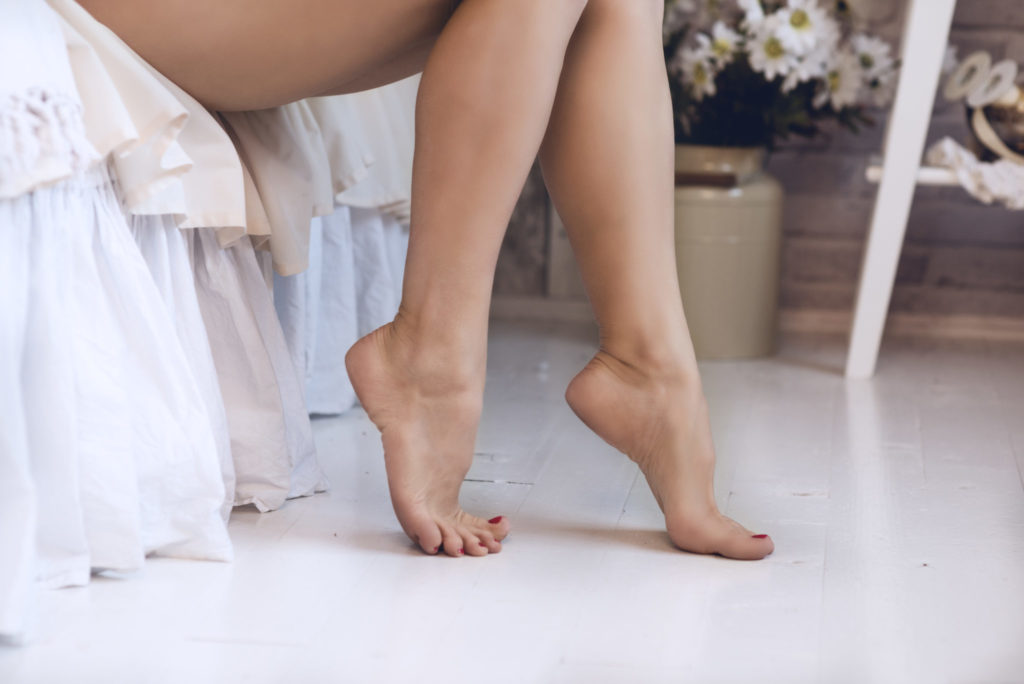 Woman legs with soft skin in the bedroom