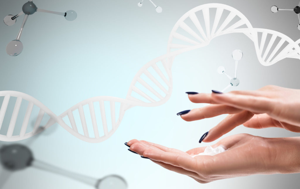 Female hands with cosmetis cream over dna and molecules background.